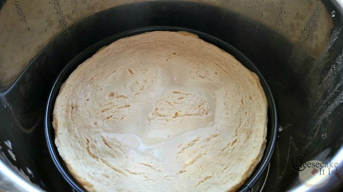 Cooked coconut cheesecake inside the Instant Pot.