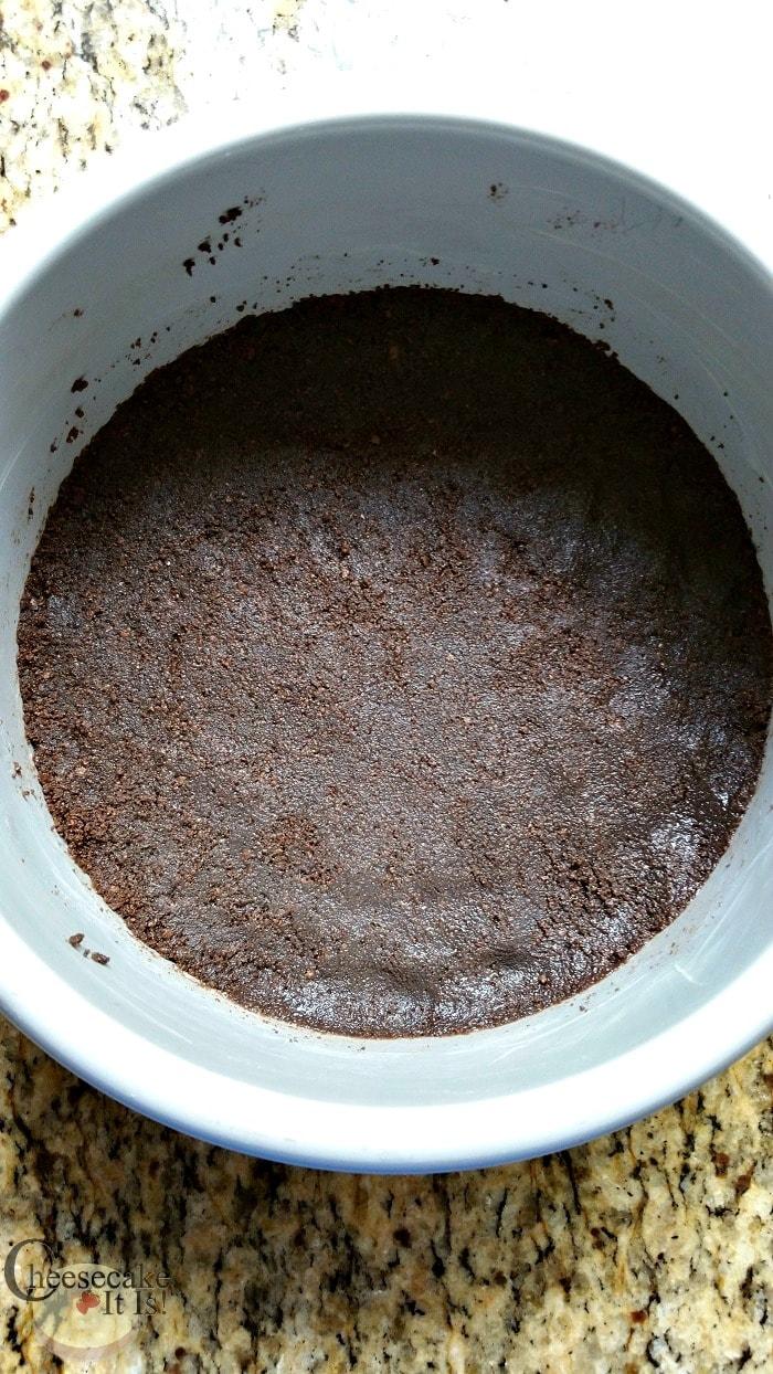 Cheesecake pan with chocolate crust on the bottom.