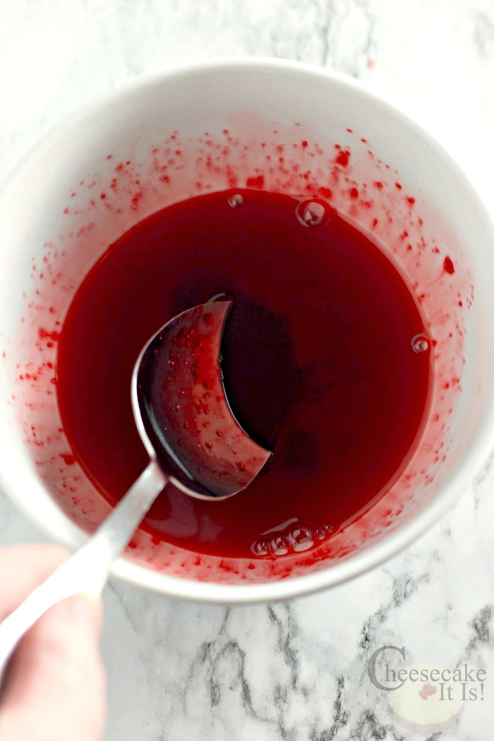 Red jello liquid mixed in bowl
