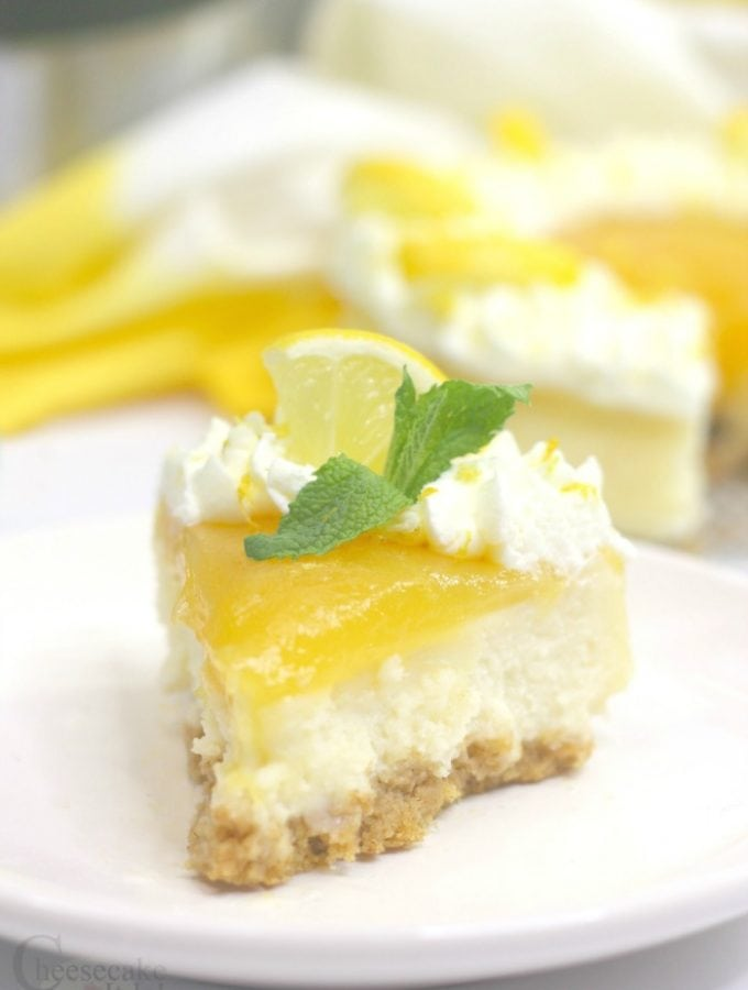 Slice of lemon cheesecake on white plate