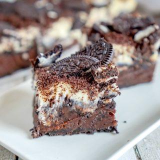 Oreo Cheesecake Brownie Bars on white plate