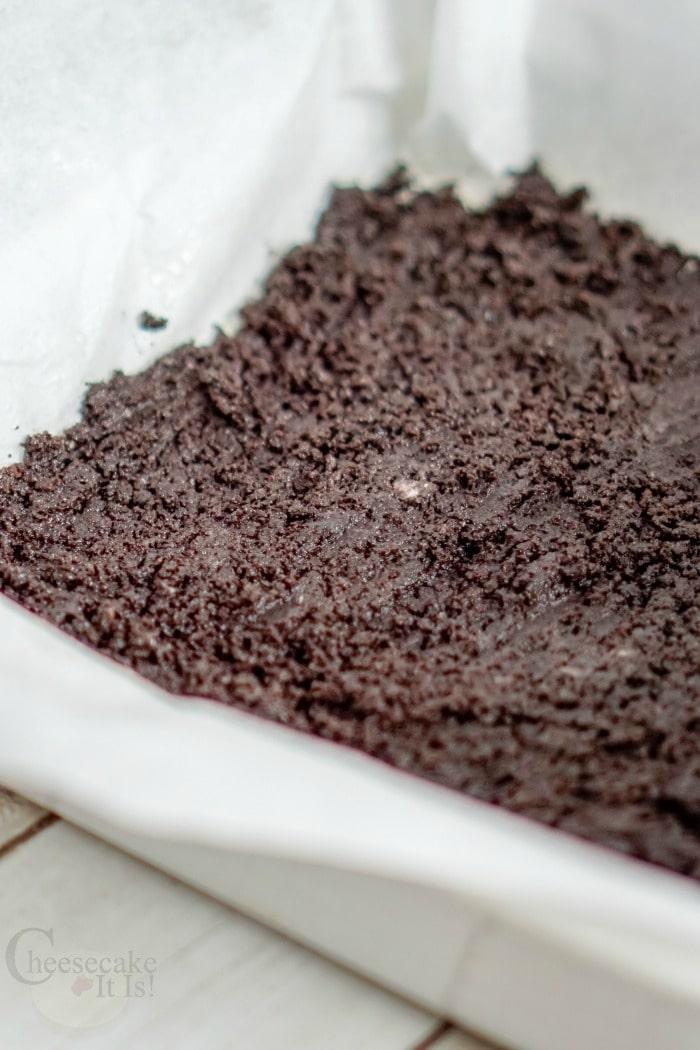 Oreo crust pressed into pan