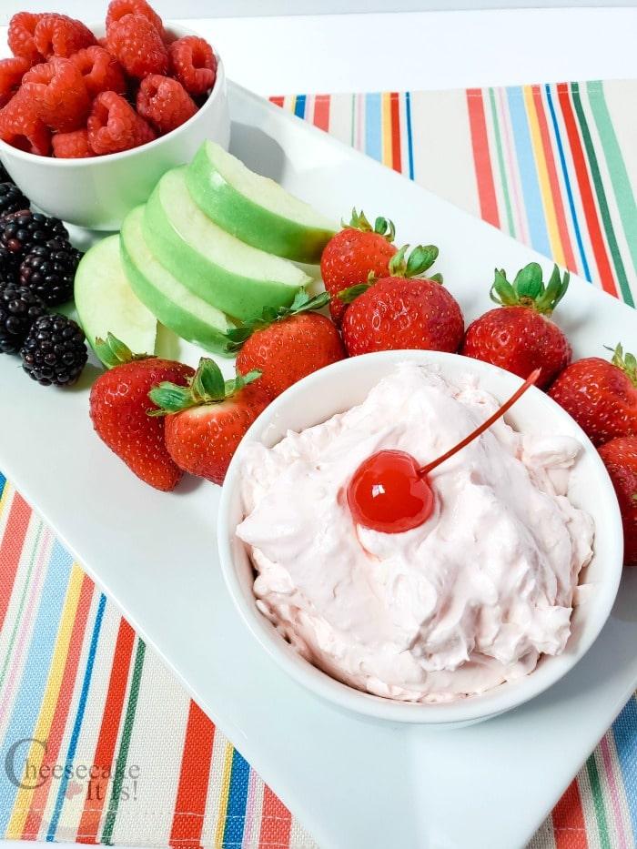 Cherry Cheesecake Fluff Dip with fresh fruit around