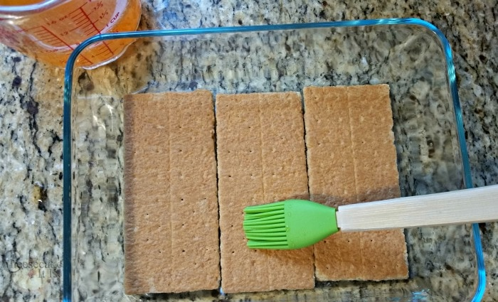 Coating crackers with soda